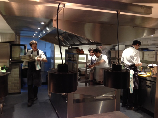 THE BRIGADE AT WORK IN THE KITCHEN