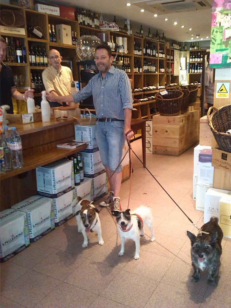 Phil and his dogs using the local shops.