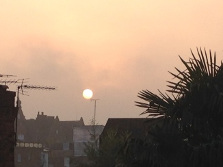 September sunrise over the rooftops.