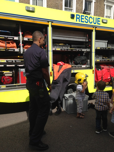 TRYING ON THE FIREFIGHTERS' KIT