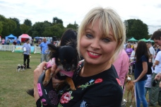 A PUPAID SUPPORTER AND HHER CUTE DOG